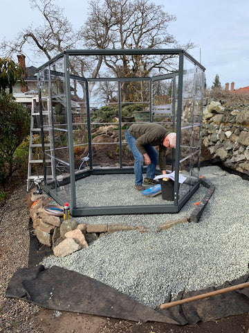 assembling the frame for the greenhouse panels