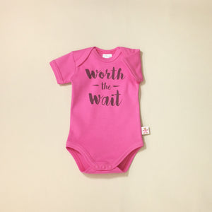 Worth the Wait Fuchsia graphic baby snap bodysuit