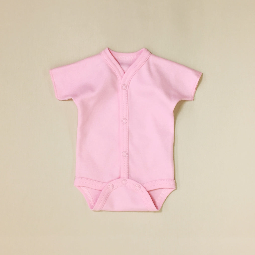 Front snap opening pink baby bodysuit