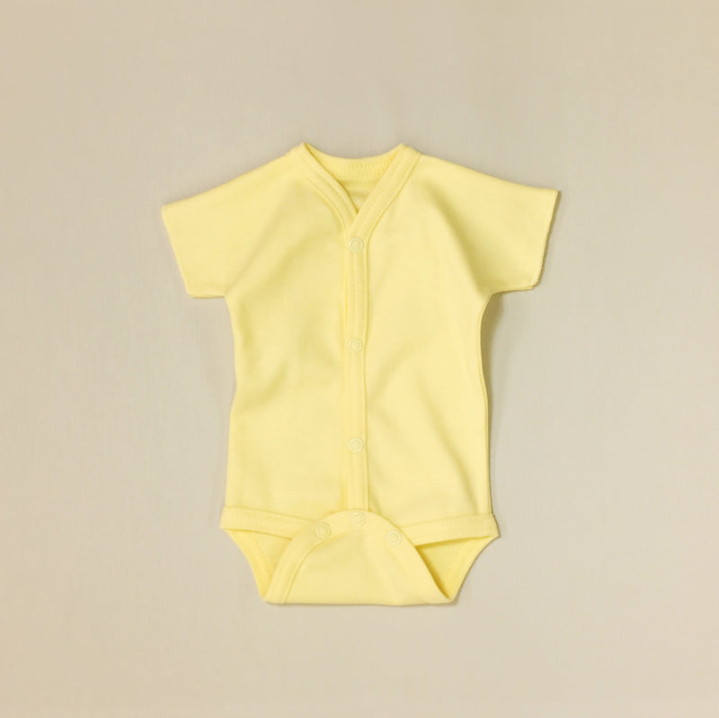 Front snap opening yellow baby bodysuit