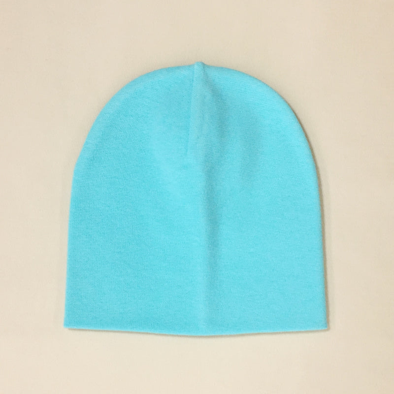 turquoise cotton baby hat with brim