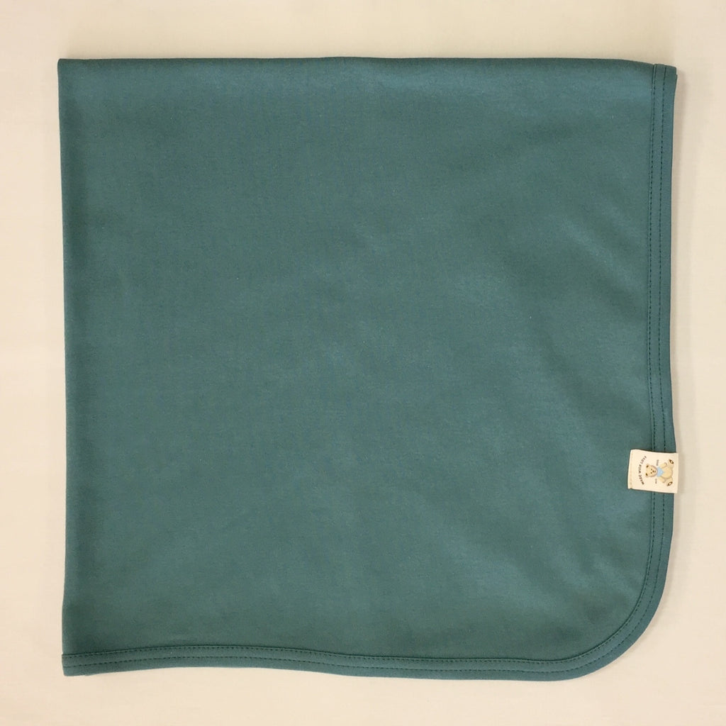 Minimalist cotton baby swaddle blanket in Spruce Forest. Made in Canada