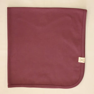 Minimalist cotton baby swaddle blanket in Crushed Berry. Made in Canada