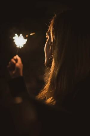 woman-holding-sparkler-at-night