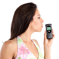 Woman Using BACtrack Element Professional Breathalyzer