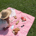 Girl laying on picnic blanket with food and Water Melon Tote Bag
