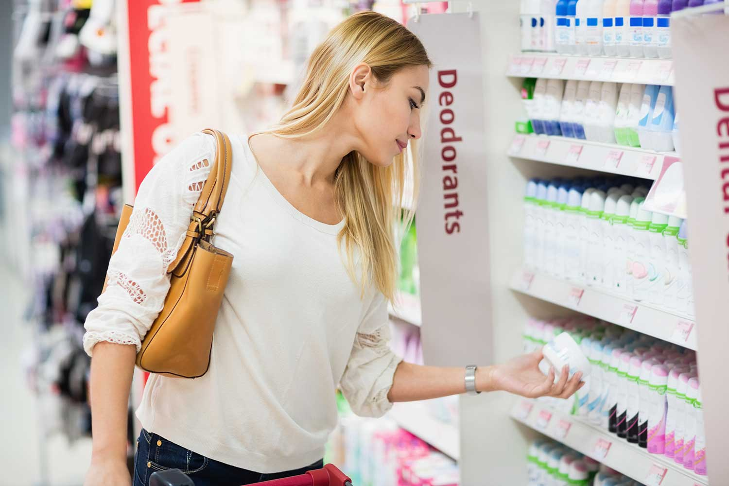 woman with long blonde hair shopping for deodorant