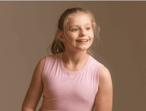 Girl wearing KayCey supersoft sleeveless Pink popper vest for older children