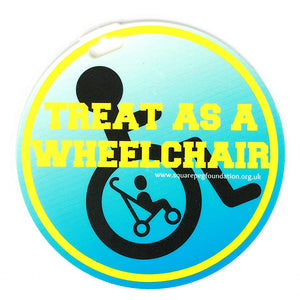 square_peg_blue_treat_as_wheelchair_user_badge_on_clip_on_buggy_special_needs
