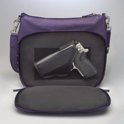 Gun in Concealed Carry Handbag