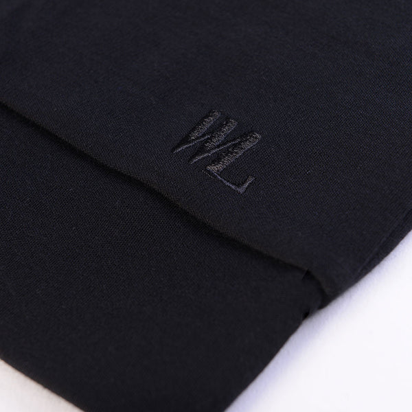 WoolLand Norway - Hokksund Merino Wool Men's V-Neck Jumper - Pure Black (logo detail)