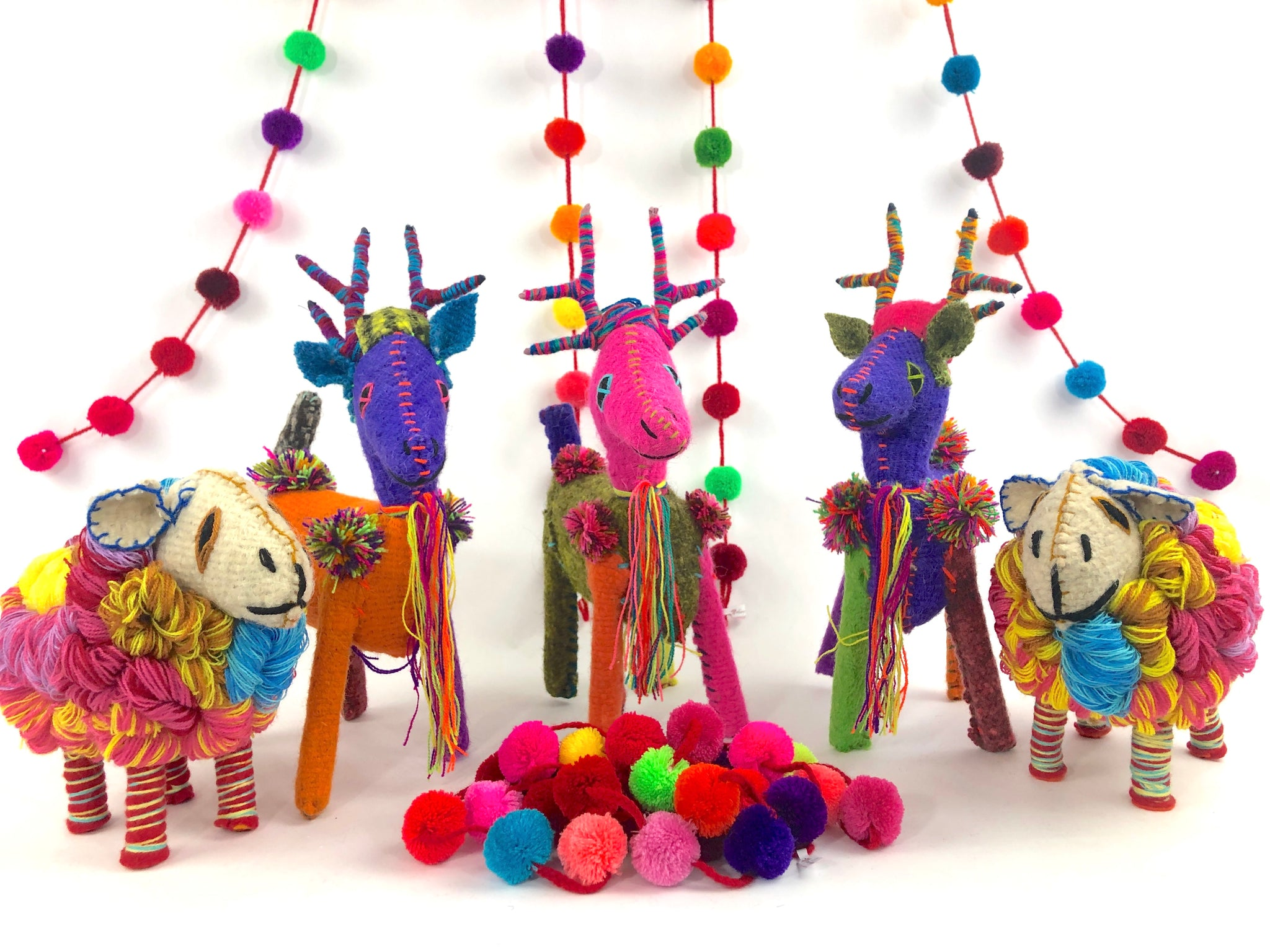 Colorful Mexican holiday decorations, colorful reindeer, Mexican folk art, pompom chains, fair trade Mexican Christmas decorations