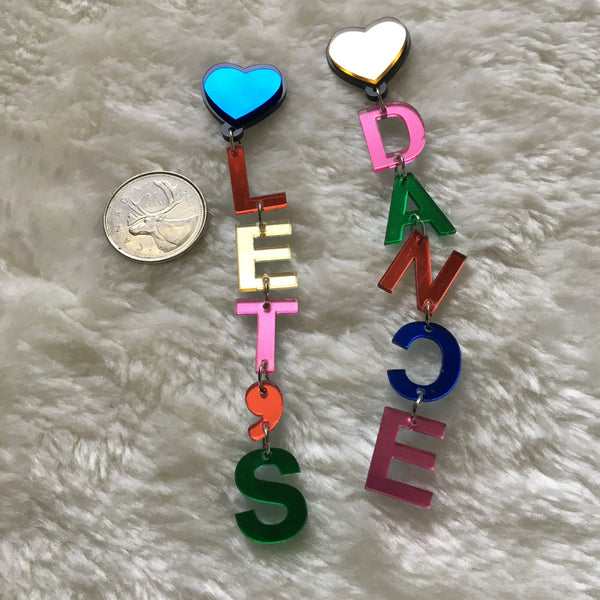 "Heart multicolour letter dangle earrings that read ""Let's Dance"""