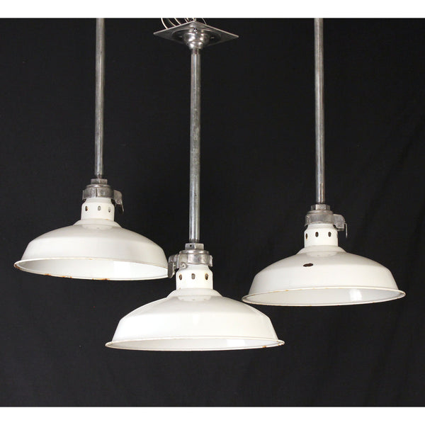 Set of Three White Enamel Shade Industrial Pendants