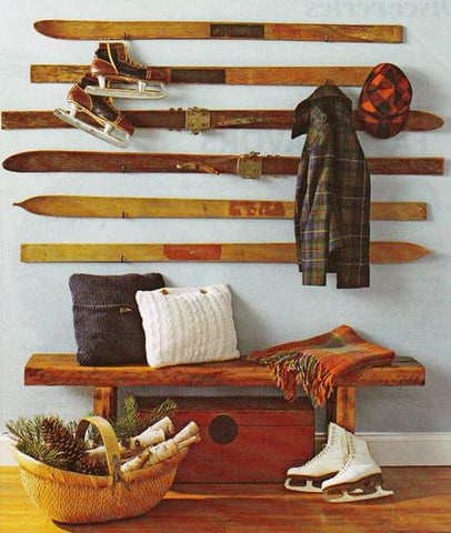 Using recycled vintage skis as wall decor for a ski lodge