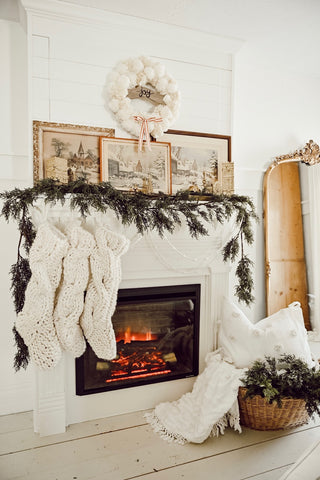 A white Christmas with chic mantelpiece decor
