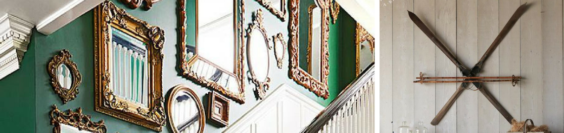 Antique wall decor graphic with antique gold mirrors on a green wall and mounted skis