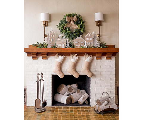 Elegant, cosy and minimalist mantelpiece style, ready for Christmas