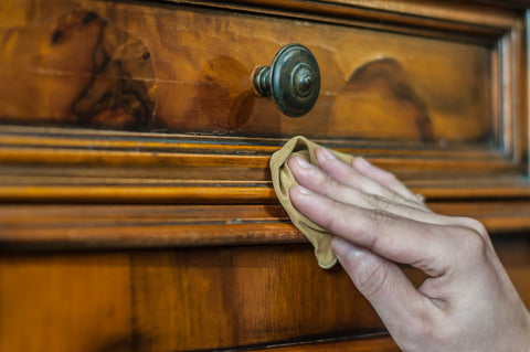 antique furniture restoration buff with wax