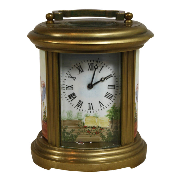 Antique Oval Brass and Glass Clock with Cherubs