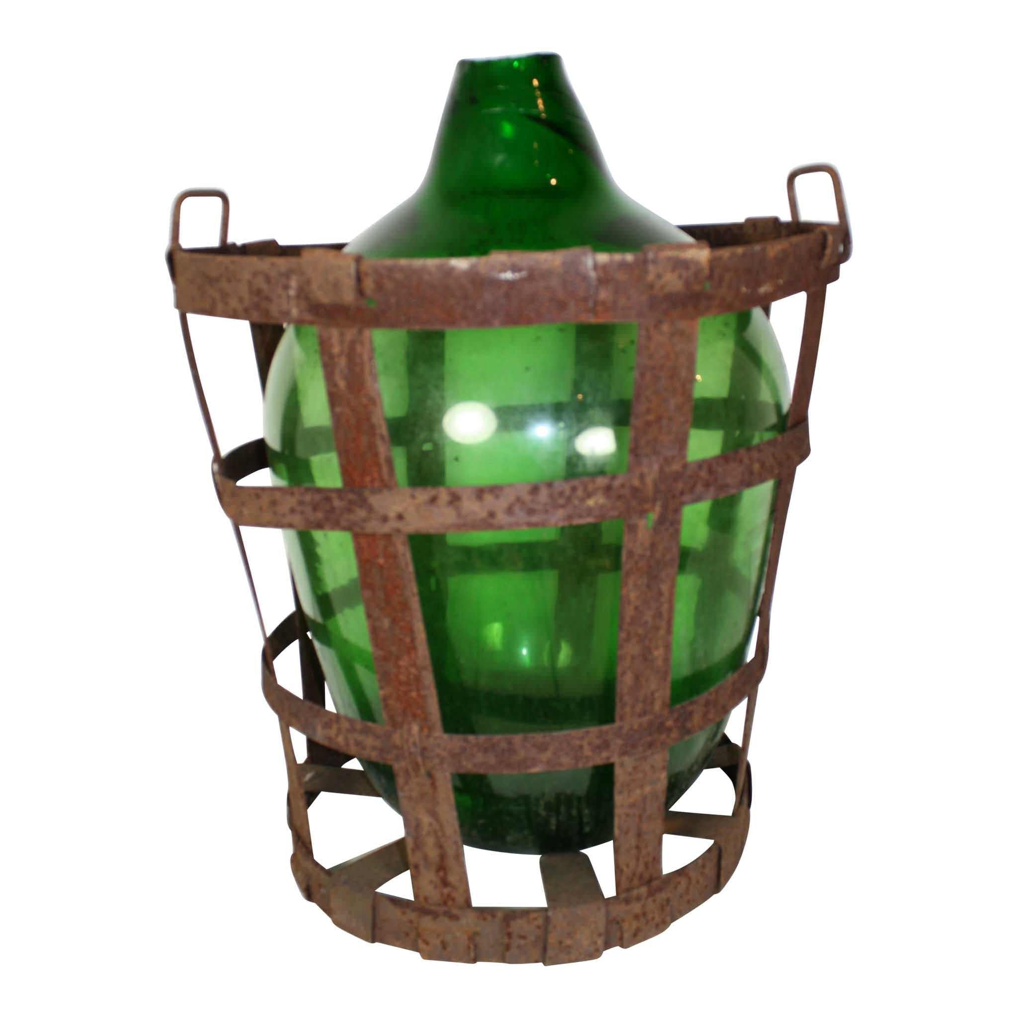 Green Glass Bottle in Metal Basket