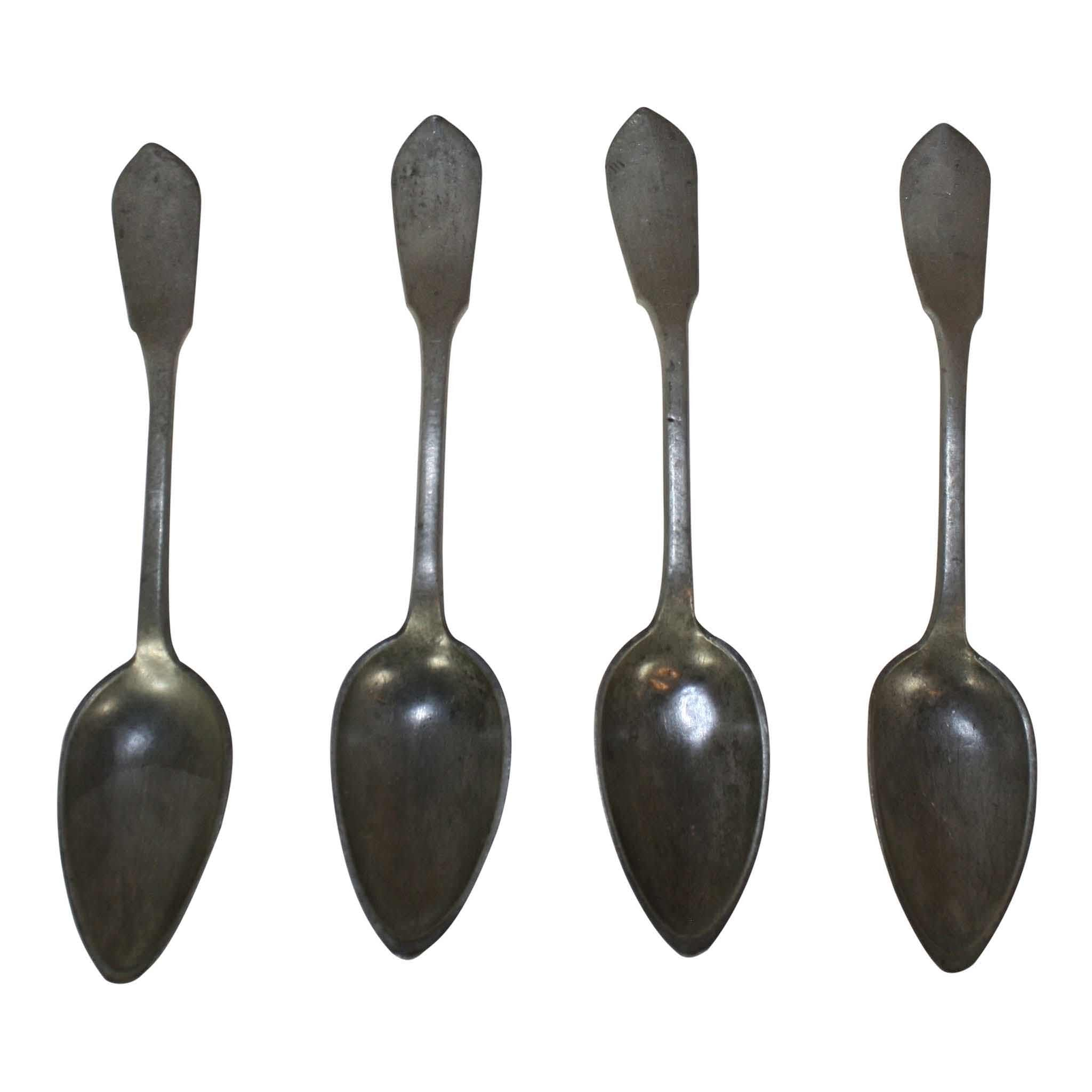 Four Pewter Spoons in Rack