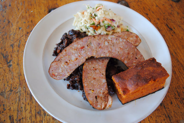 7/22 Smoked Hot Link, BBQ Beans, Coleslaw & Kimchi Cornbread