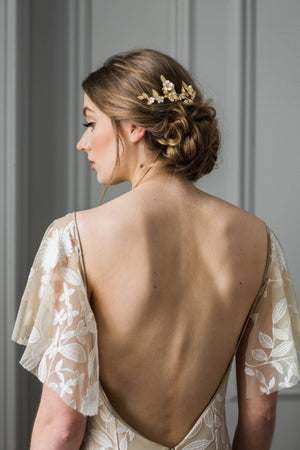 Bride wearing a hair comb made of vines and flowers