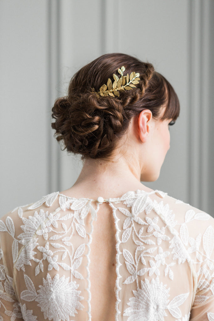 Bride wearing a gold leaf tiara in her hair