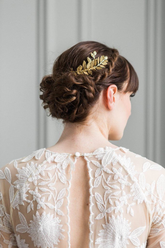 Bride wearing a gold leaf comb in her hair