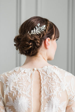 Bride wearing a silver leaf comb in her hair