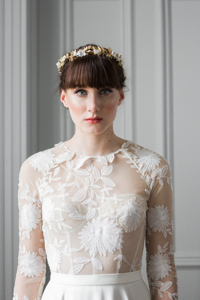 Model wearing a gold leaf bridal crown tiara