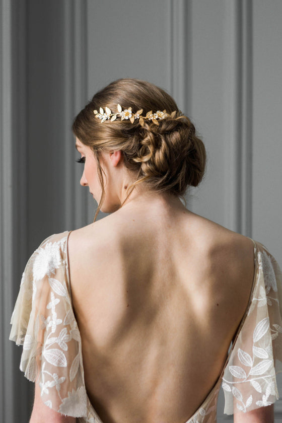 Bride wearing a wreath headpiece made of gold vines and flowers