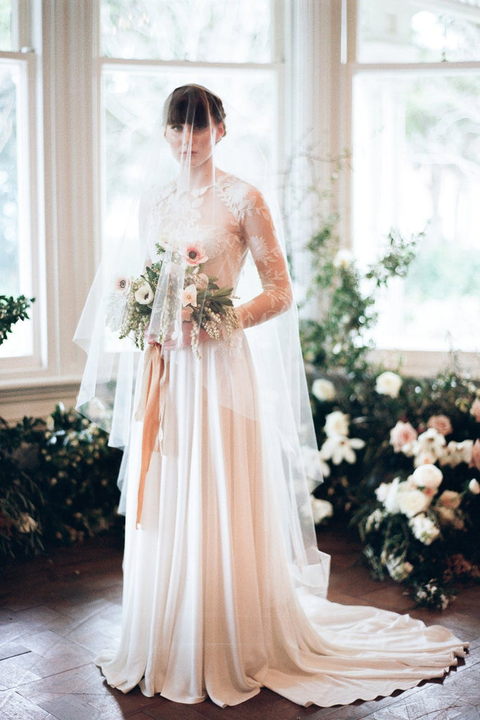 Beautiful bride in wedding dress wearing a classic bridal viel
