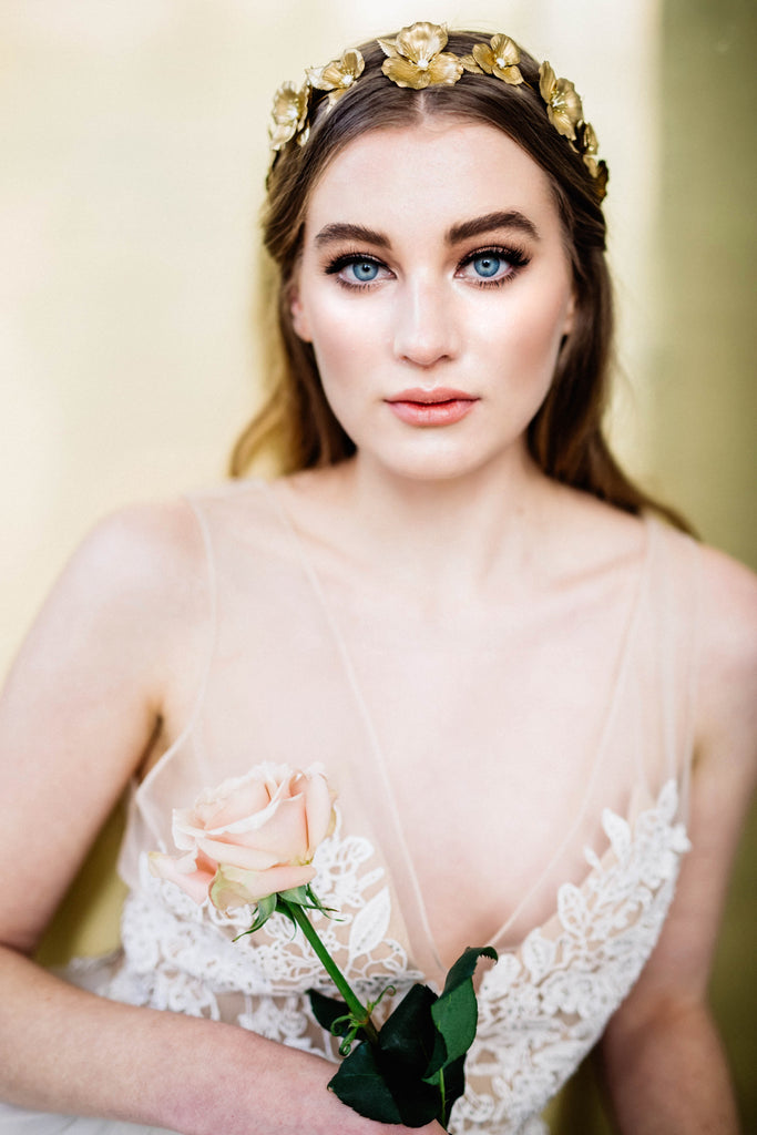 Model wearing a bridal tiara made of gold flowers