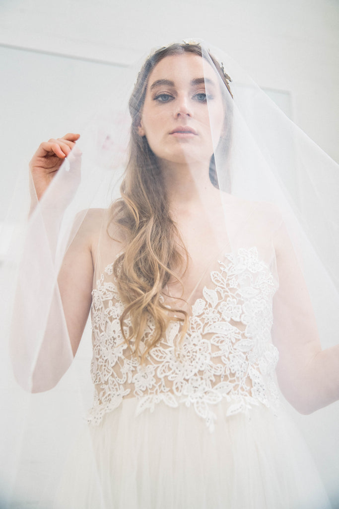 Bride in wedding dress wearing a classic bridal veil