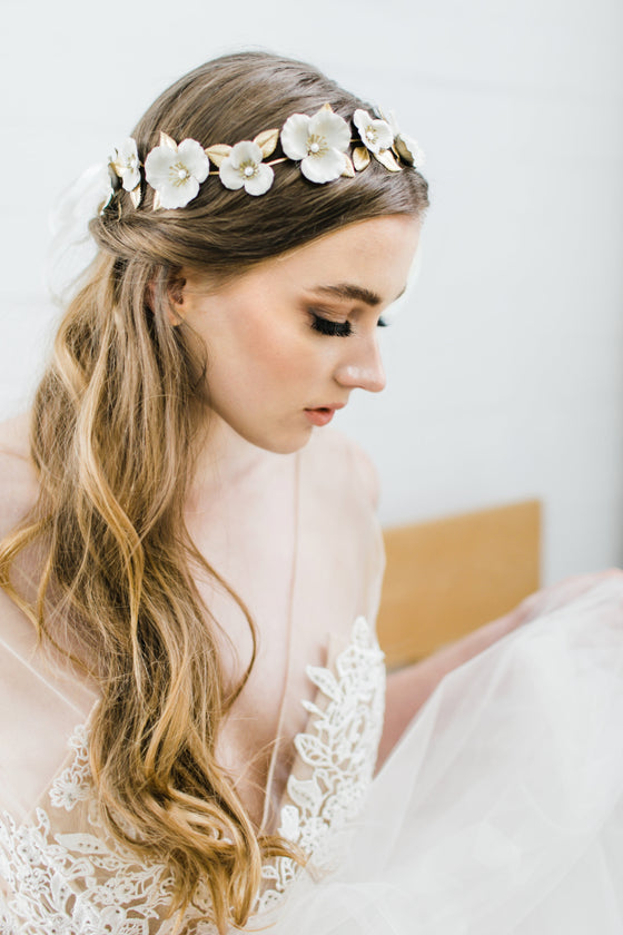 Bride wearing a circlet crown made of gold and ivory flowers