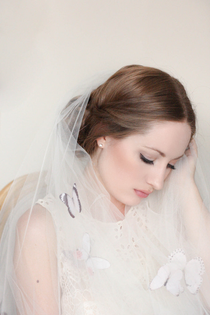 Bride wearing a dramatic silk butterfly veil