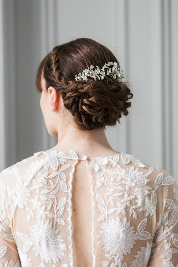 Model wearing a bridal hair comb made of silver leaves