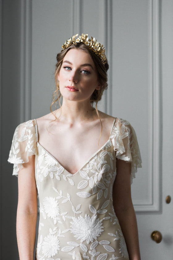 Bride wearing a gold laurel leaf flower crown