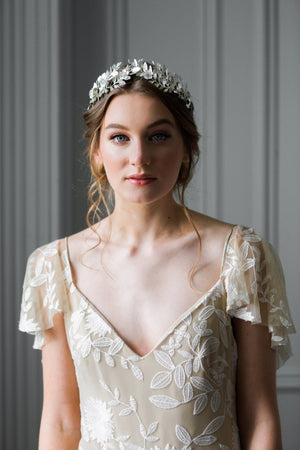 Bride wearing a silver laurel leaf flower crown