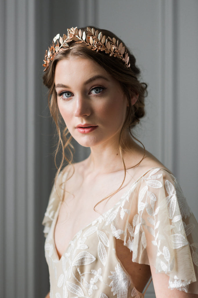 Bride wearing a rose gold laurel leaf tiara
