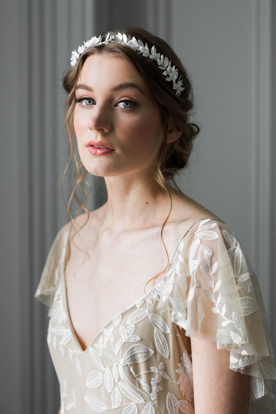 Bride wearing a silver tiara with silk flowers