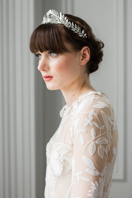 Bride wearing a silver leaf flower crown