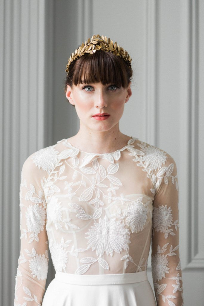 Bride wearing a gold leaf flower crown