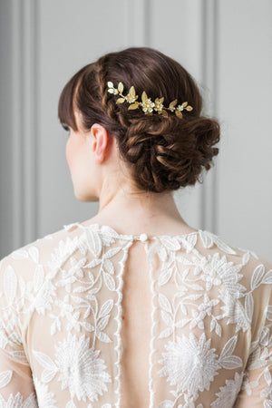 Bride wearing a gold leaf bridal hair comb