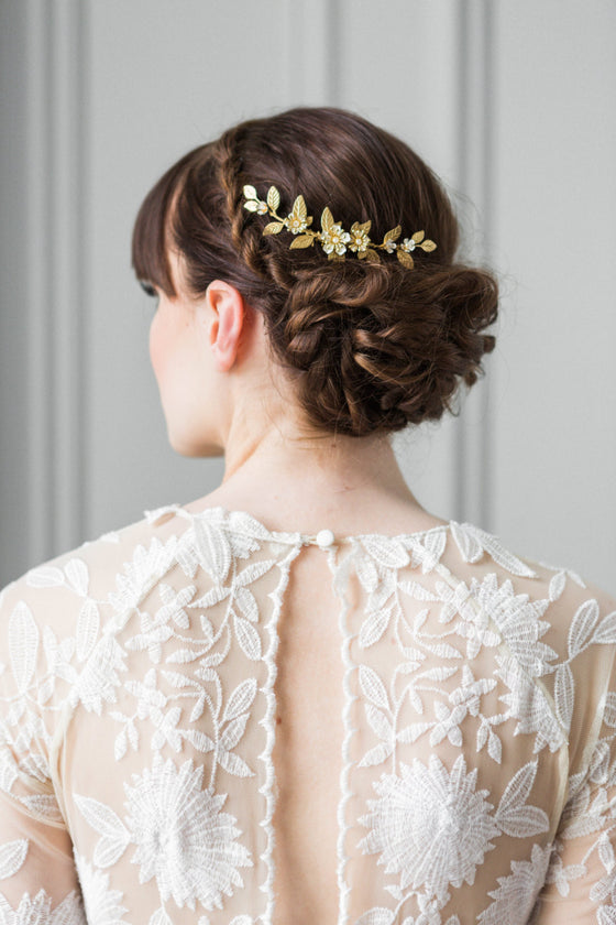 Bride wearing a gold leaf bridal comb in her hair