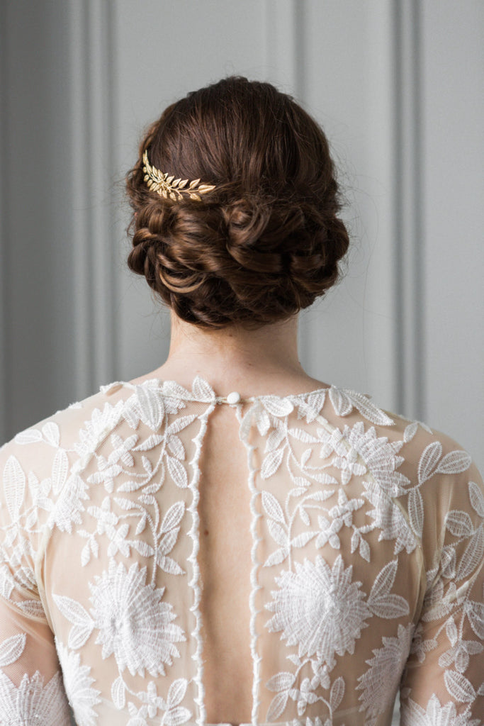 A bride wearing a gold leaf edwardian hair comb