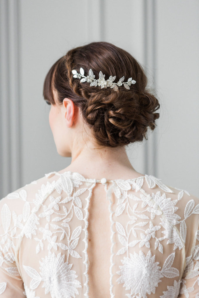 Bride wearing a silver leaf bridal comb in her hair