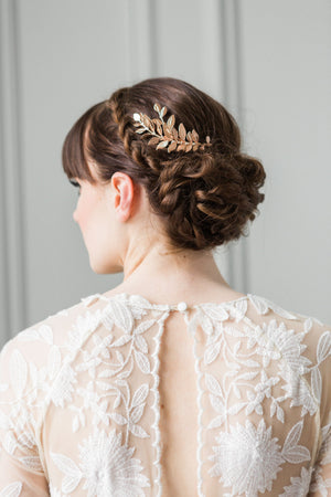 Bride wearing a rose gold leaf tiara in her hair